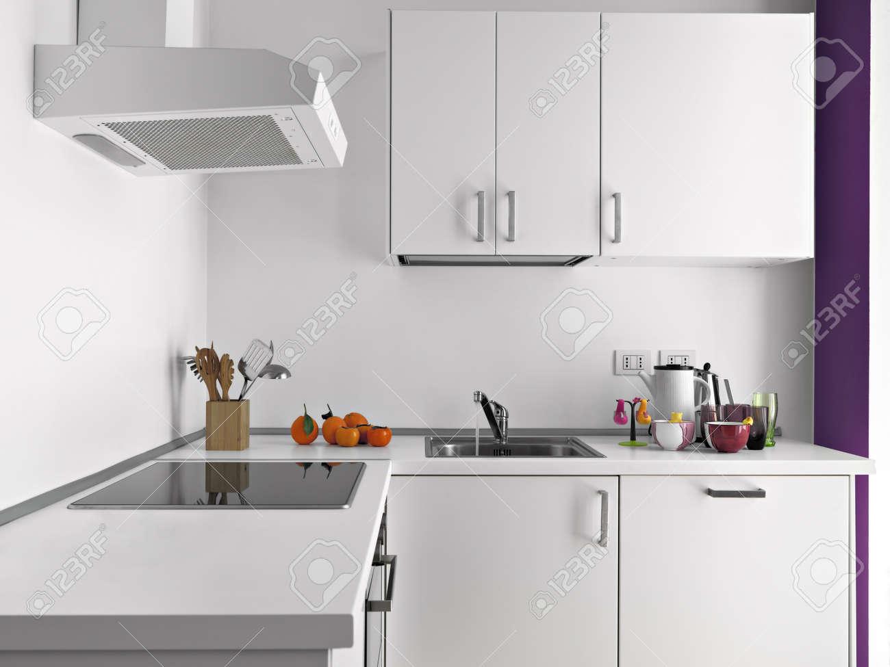 objects on the white worktop in a modern white kitchen Standard-Bild - 20019247
