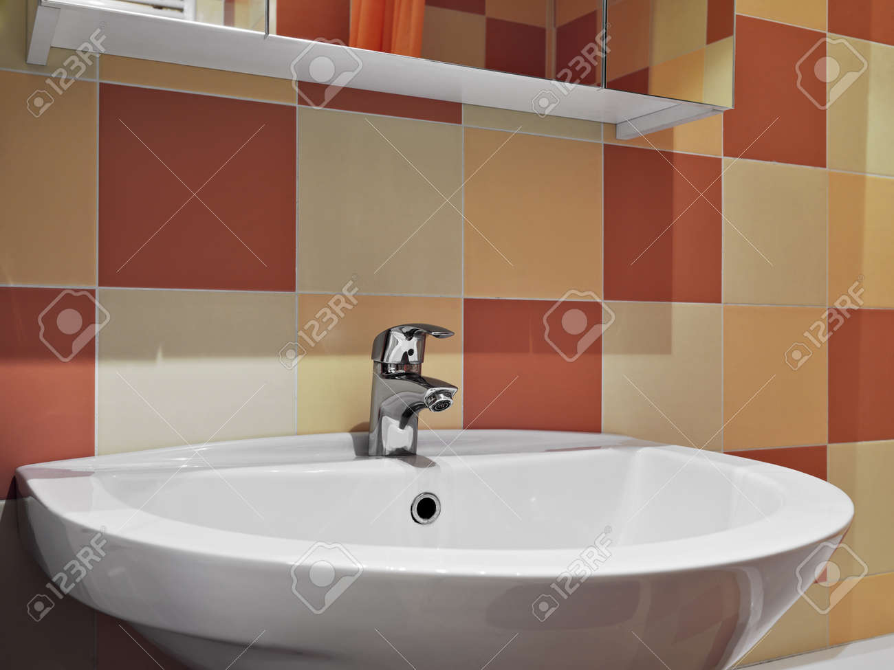 steel faucet for a washbasin with colored tiles in a modern bathroom Stock  Photo   20019249. Steel Faucet For A Washbasin With Colored Tiles In A Modern
