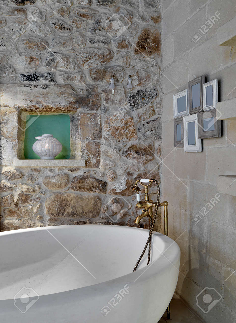 Detail Of Bathtub In A Rustic Bathroom With Stone Walls And Niche ...