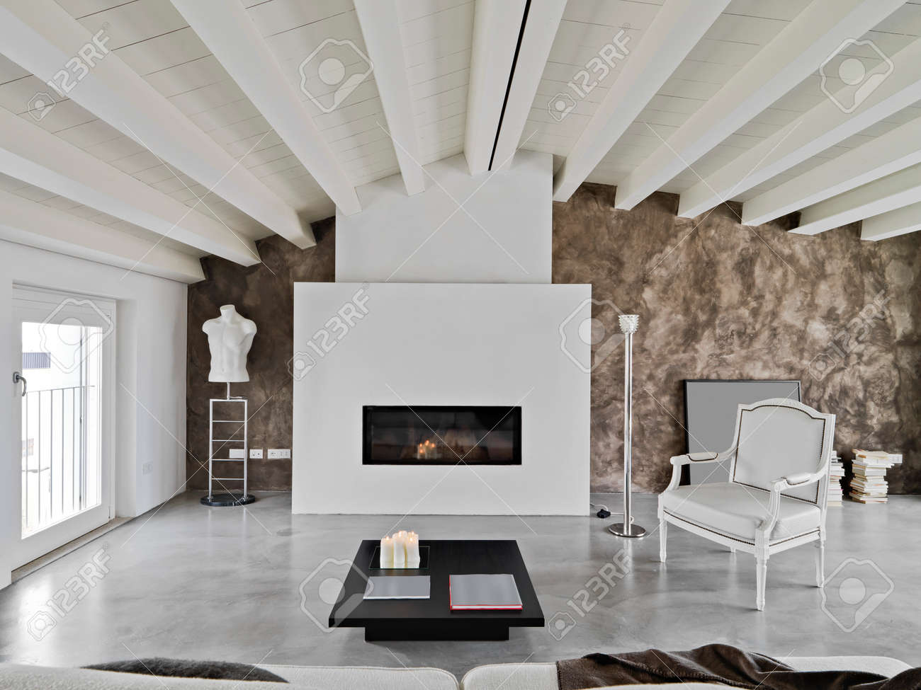 modern living room with fireplace and sofa in the attic Standard-Bild - 25456550