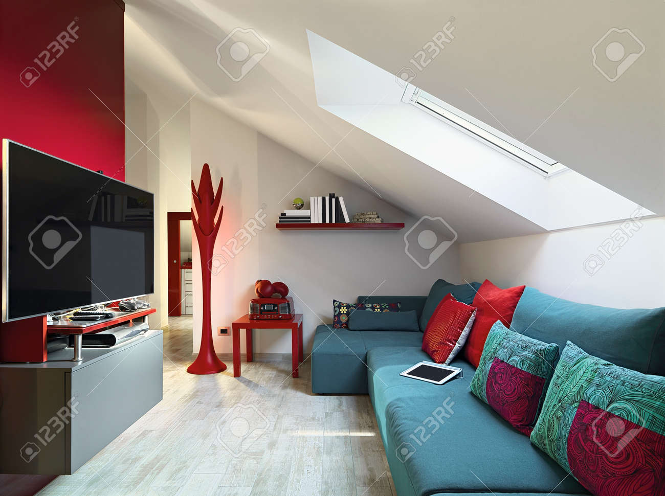 Blue Sofa In A Modern Living Room On Attic With Tile Floor Stock Photo