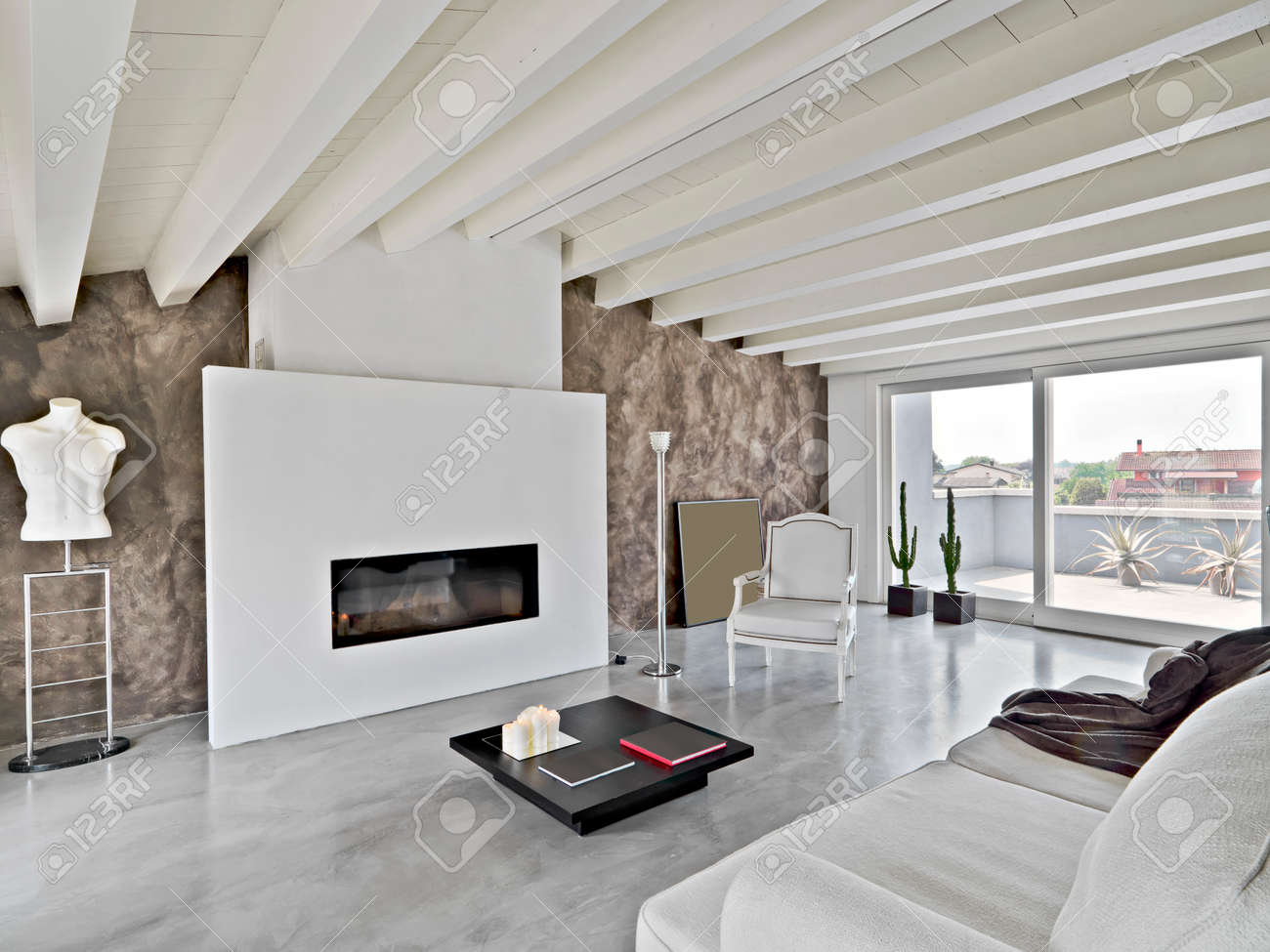 modern living room in the attic with wood ceiling Standard-Bild - 25856010