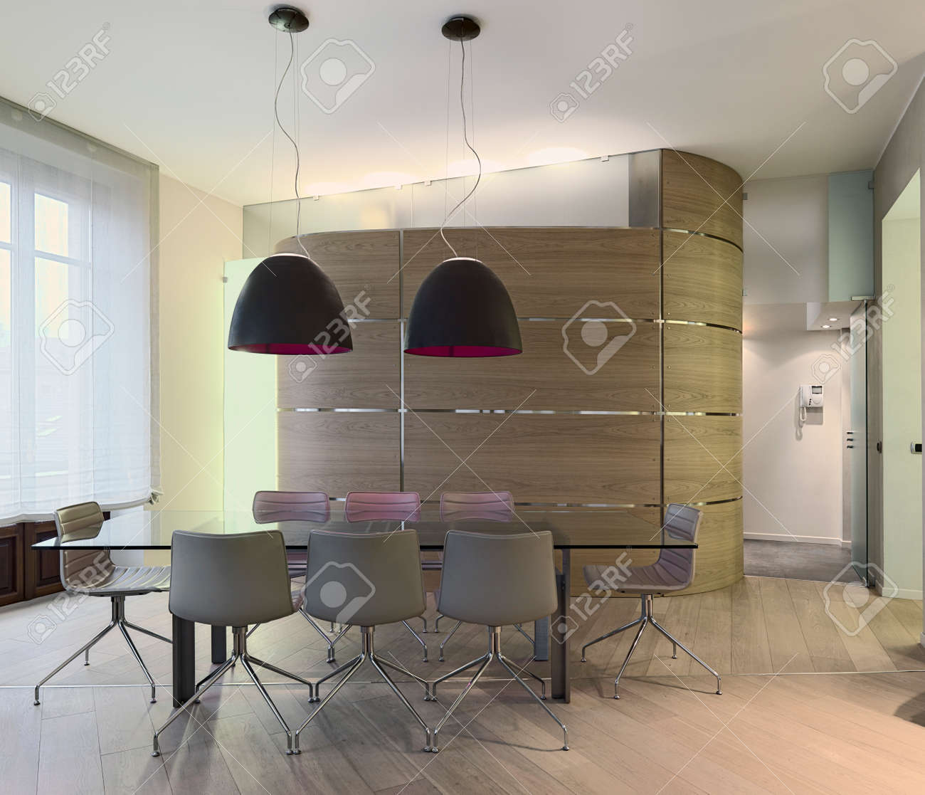 Glass Dining Table In A Modern Apartment With Boiserie And Wood ...