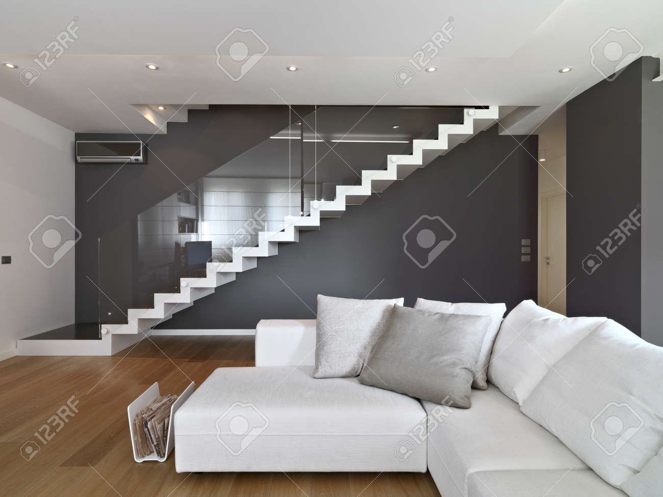 Escalier Moderne Dans Salon fabric sofa in the modern living room with staircase and wood..