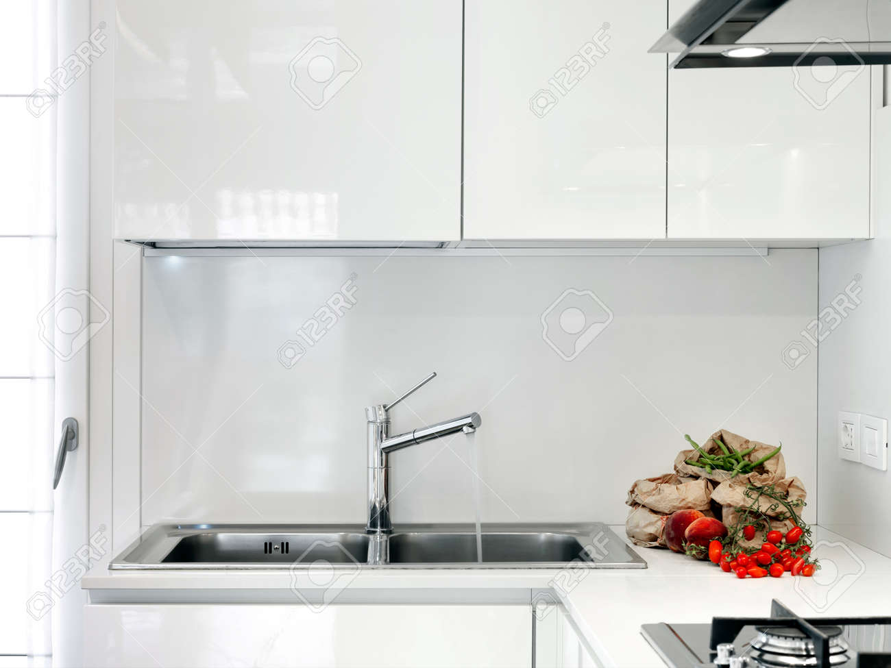 Fresh Fruit On The Countertop In A Modern White Kitchen Stock Photo ...