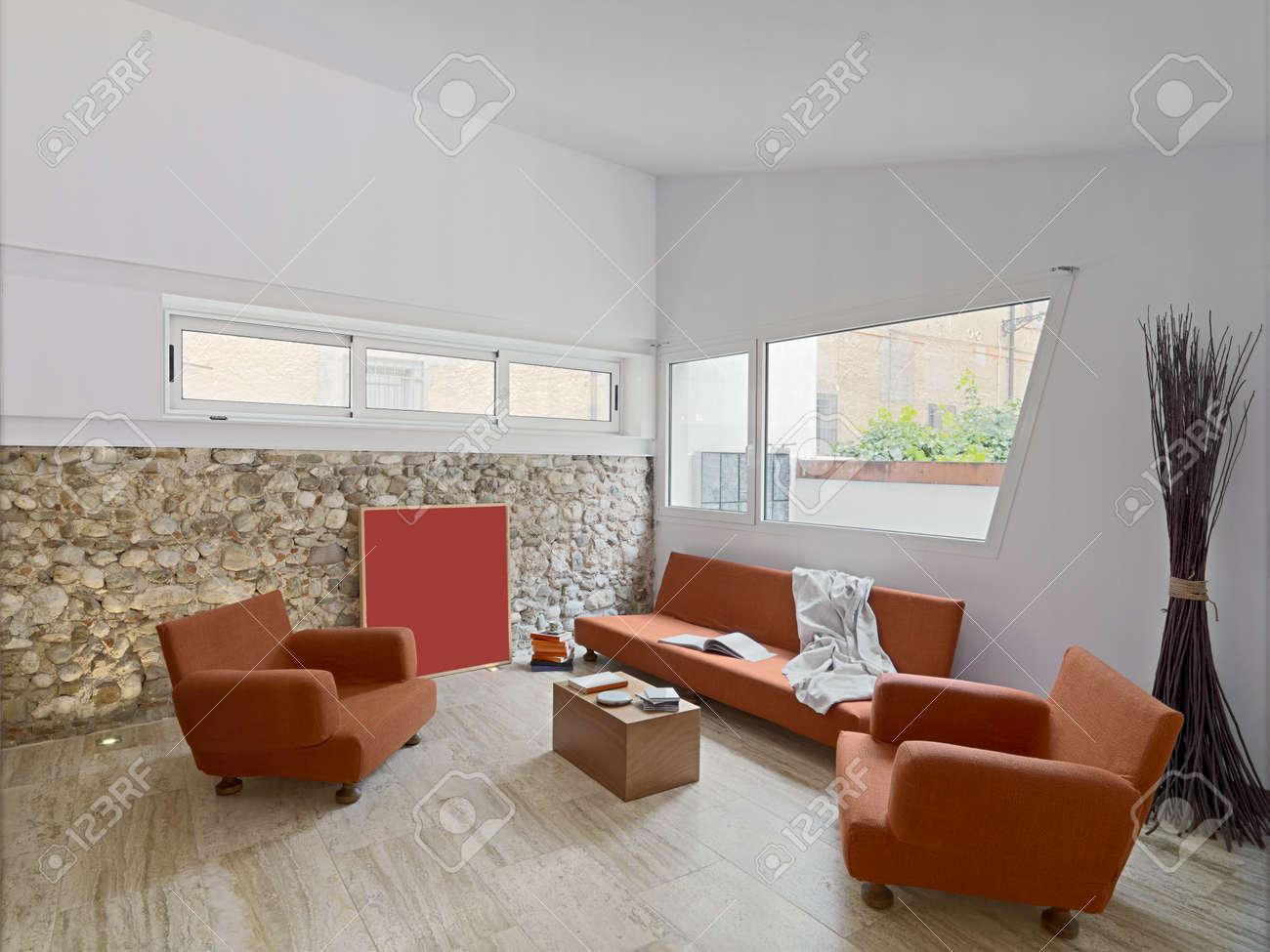 innenansicht eines modernen wohnzimmer mit orange sofa ans marmorboden und steinmauer lizenzfreie bilder 32559597 - Marmorboden Wohnzimmer