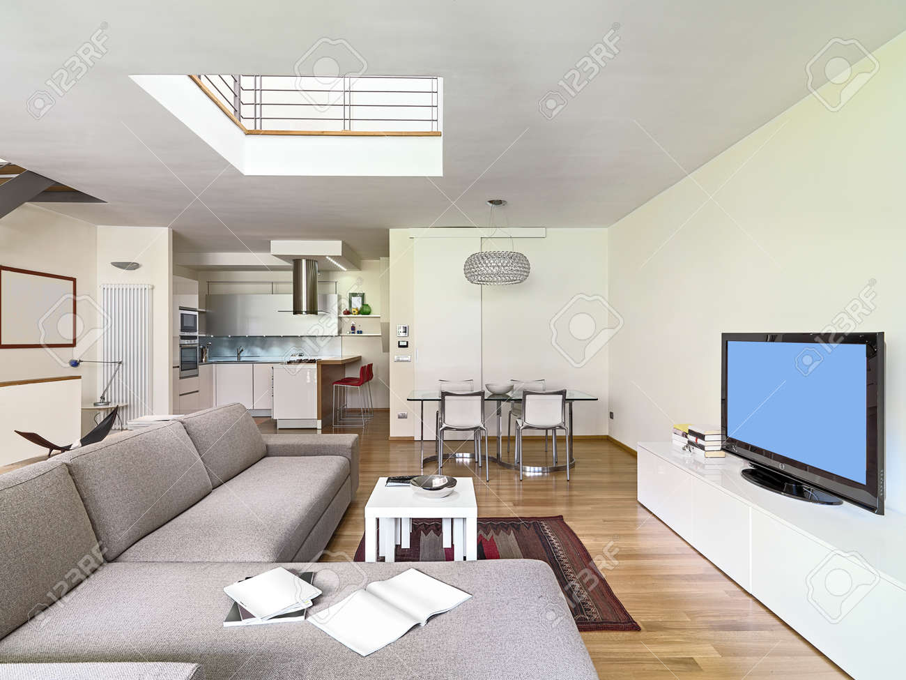 interior view of a modern living room in the attic room with wood floor  overlooking on