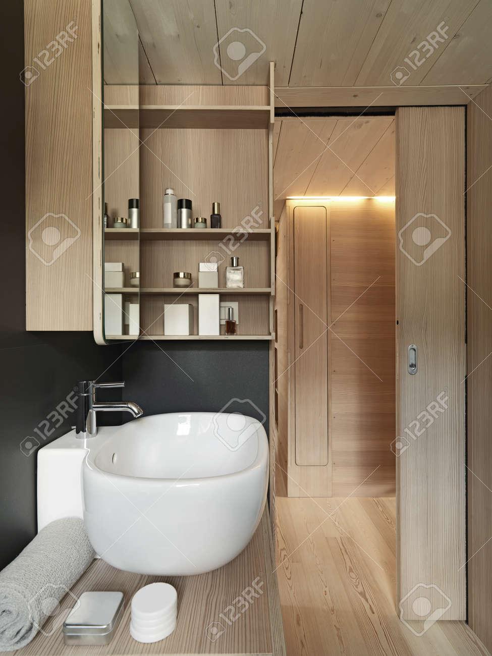 archivio fotografico stretta di lavabo in un bagno moderno con il legno porta scorrevole e pannelli di legno