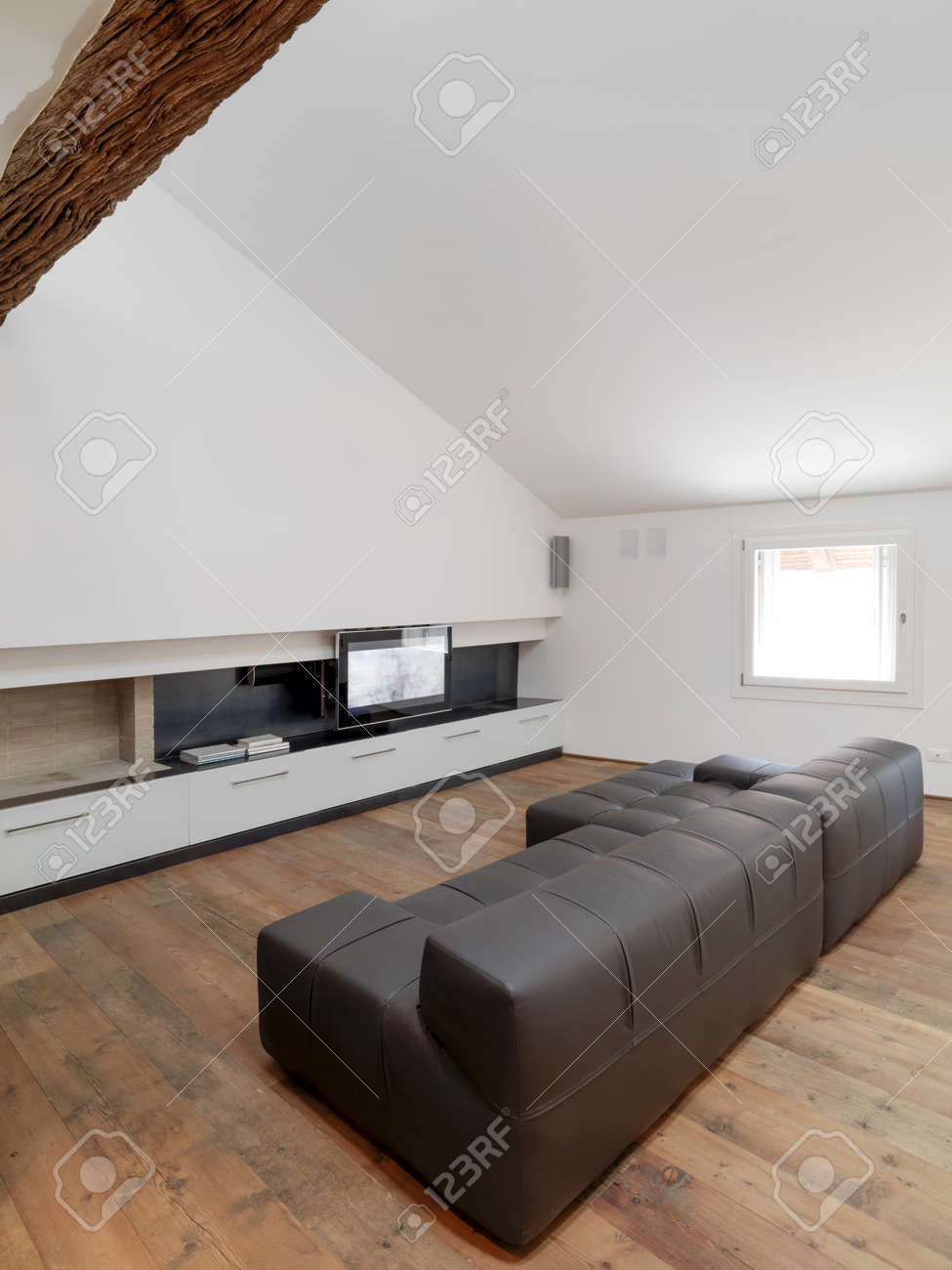 Brown Leather Sofa In The Attic Room With Television And Wood Floor For  Modern Living Room