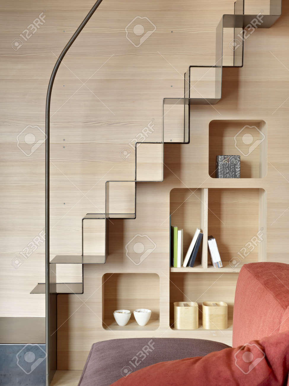 Detail Of Iron Staricase With Bookcase In The Living Room With ...