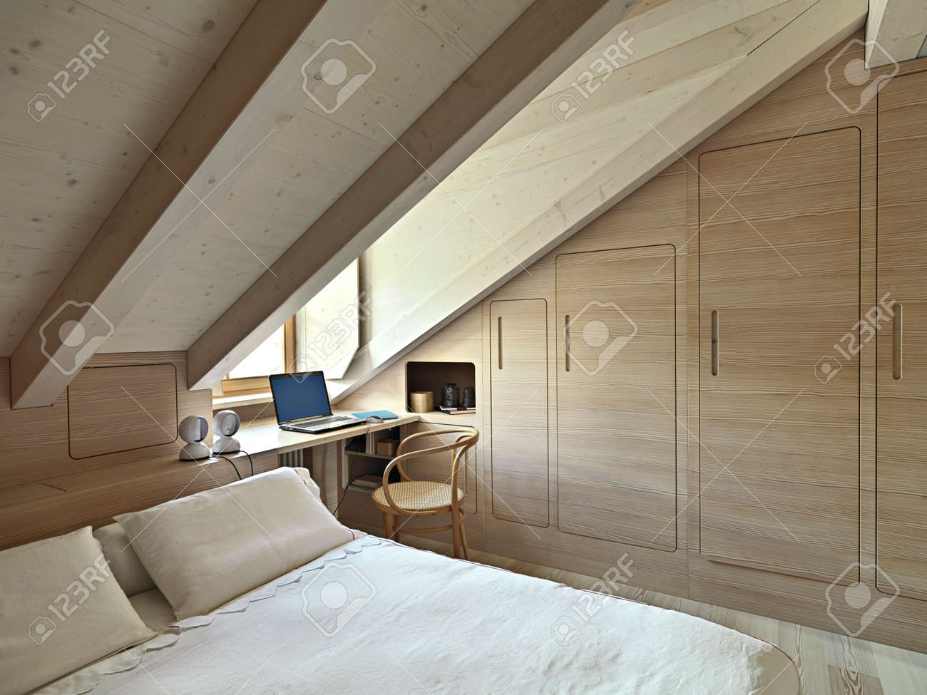 Interior View Of A Rustic Bedroom In The Attic Room With Wooden