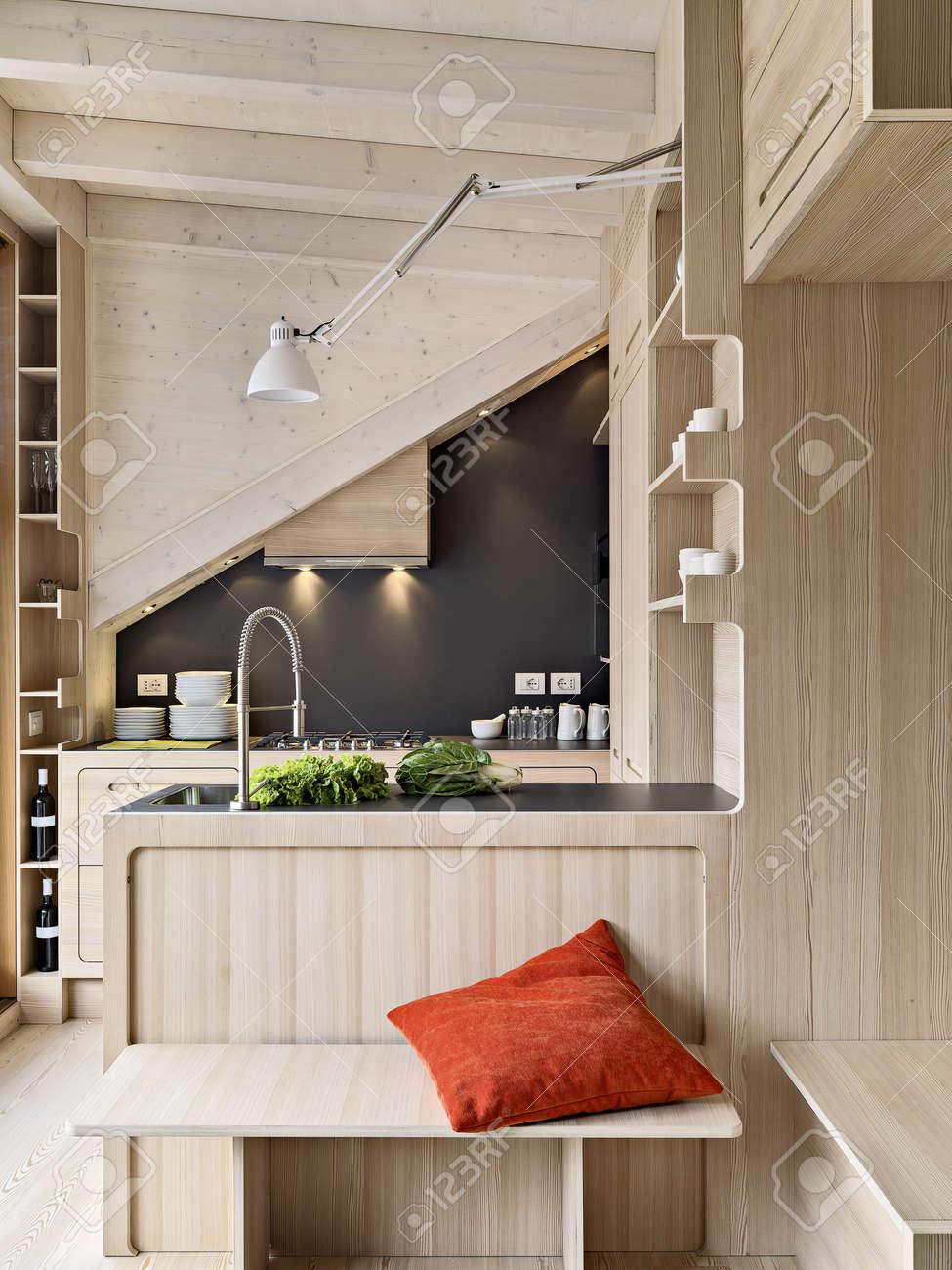 foreground on wooden modern kitchen island in the attic room Standard-Bild - 39032377