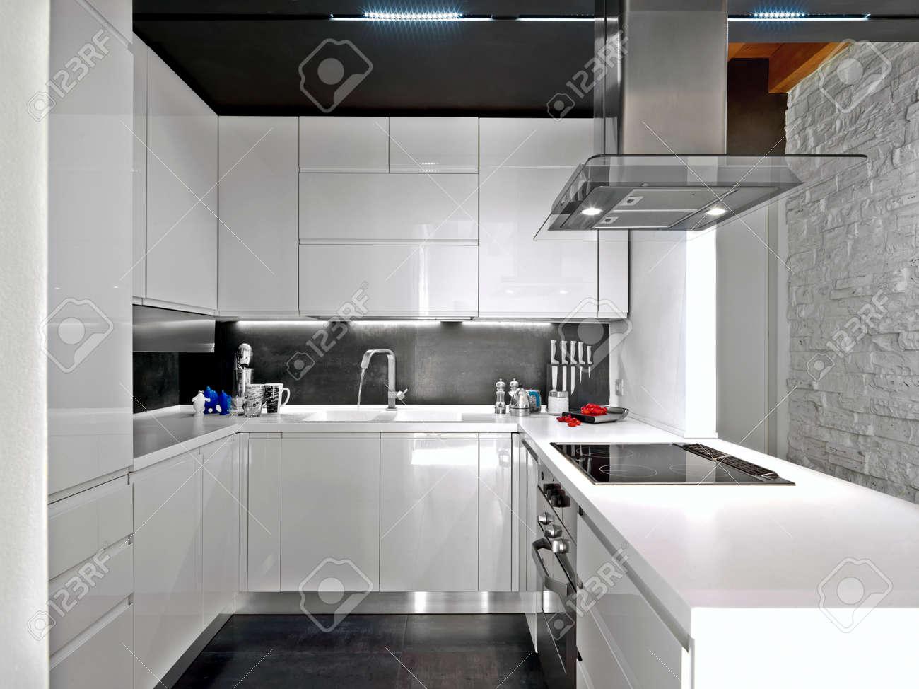 foreground of a white modern kitchen Standard-Bild - 49755030