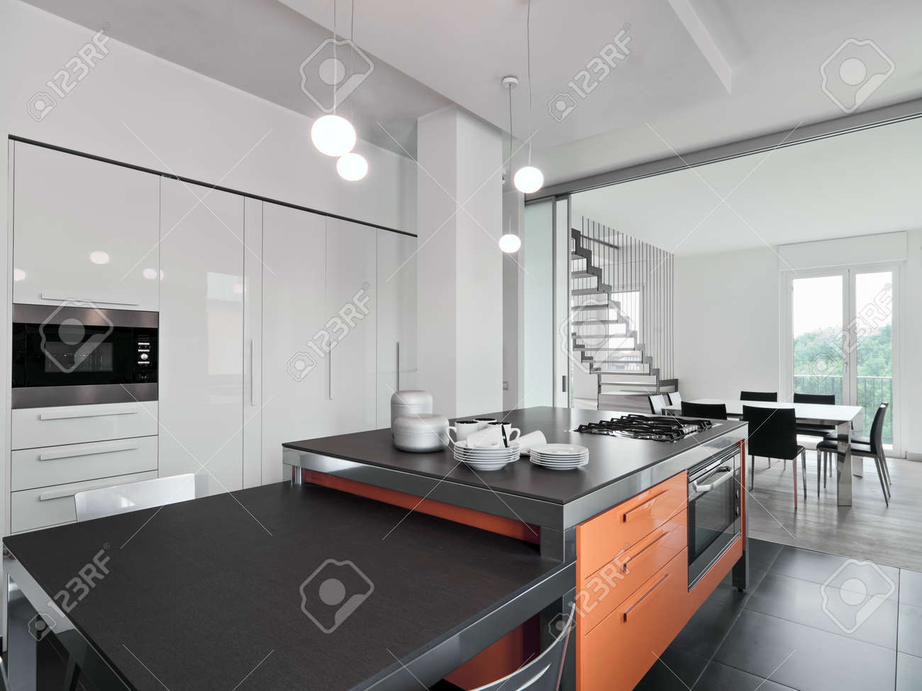 interior view of a modern kitchen with kitchen island overlooking on the dining room Standard-Bild - 49755100