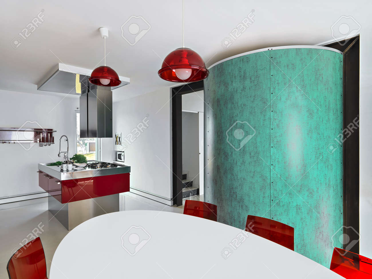 Interior View Of A Red Modern Kitchen With Kitchen Island And ...