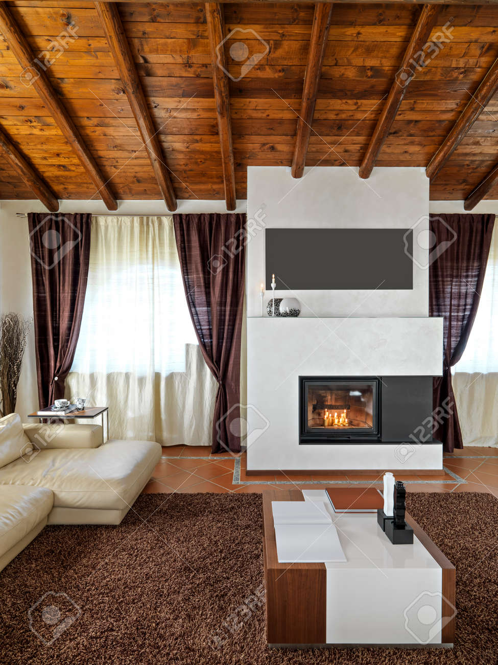 Foregroind Of A Modern Fireplace In The Living Room With Tile Stock Photo Picture And Royalty Free Image Image 53055480