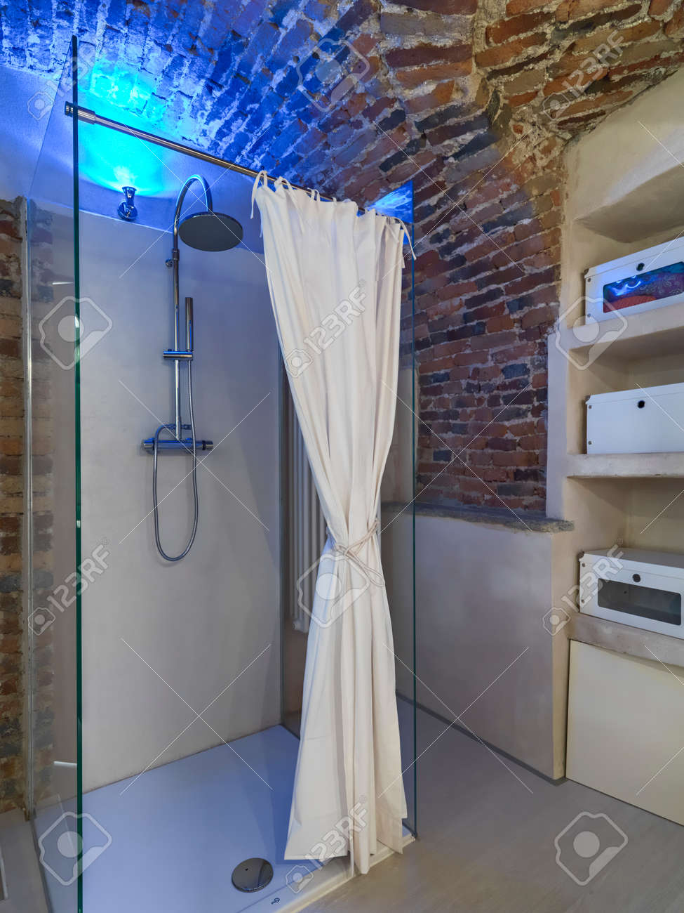Modern Glass Shower Cubicle In The Bathroom With Brick Vault Stock ...