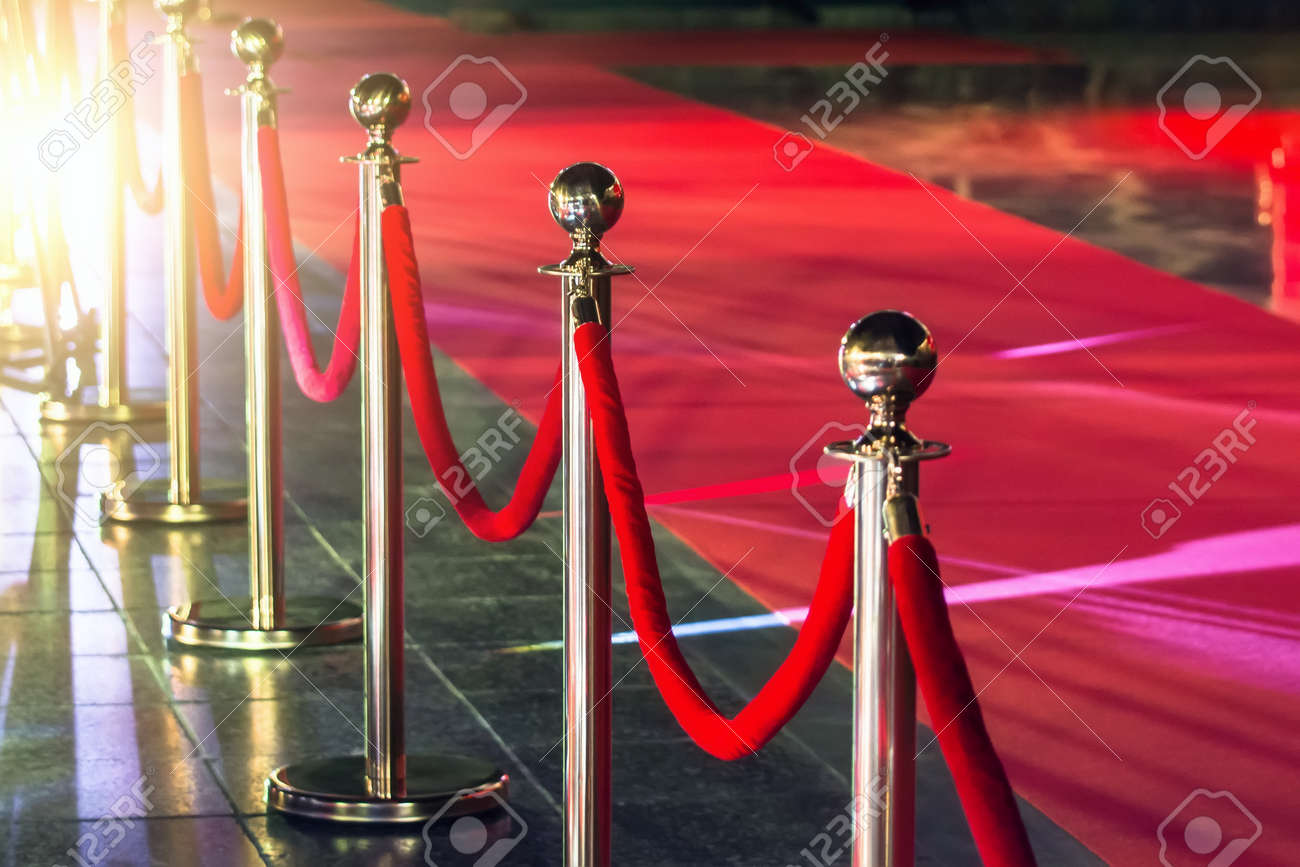 Portable Barrier for Queue Control. Red security rope by red carpet - 91315713