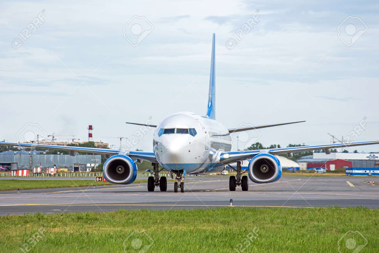 Passenger aircraft taxiing on the apron of the airport on the