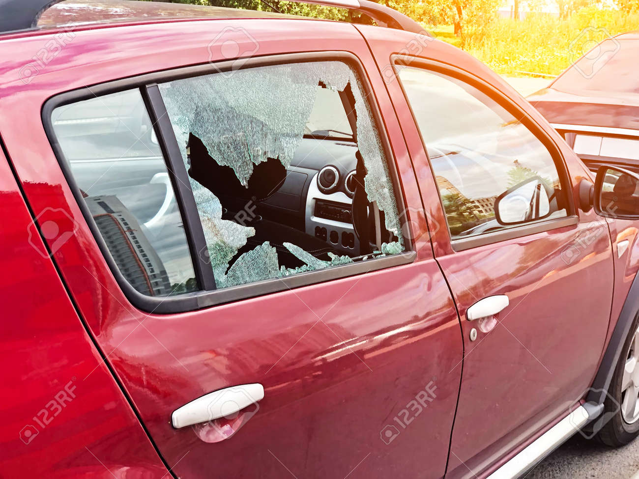 Broken glass on the passenger door of a passenger car parked. The concept of crime of car theft, theft of valuables - 126756790