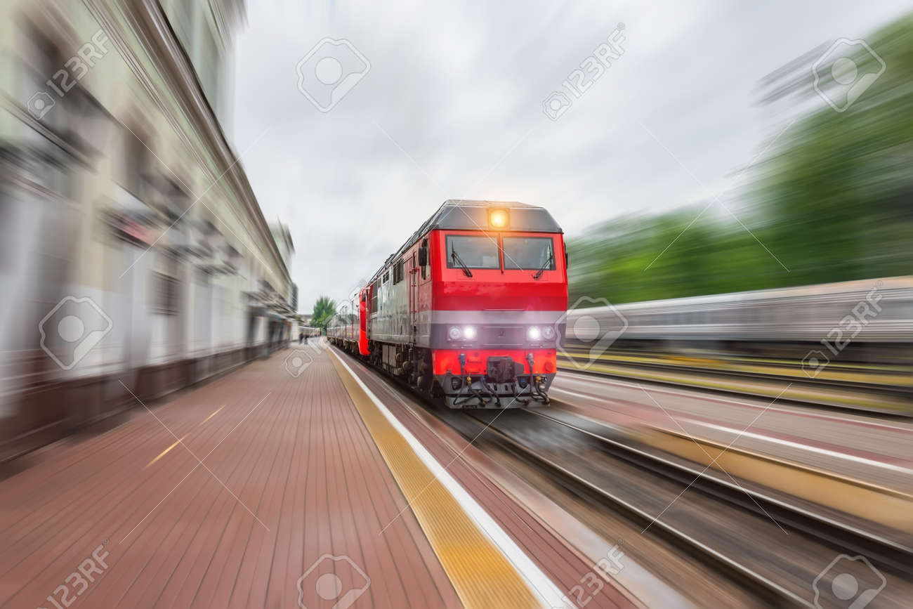 Diesel locomotive with a passenger train with a wagon rushes along the railway - 155752154