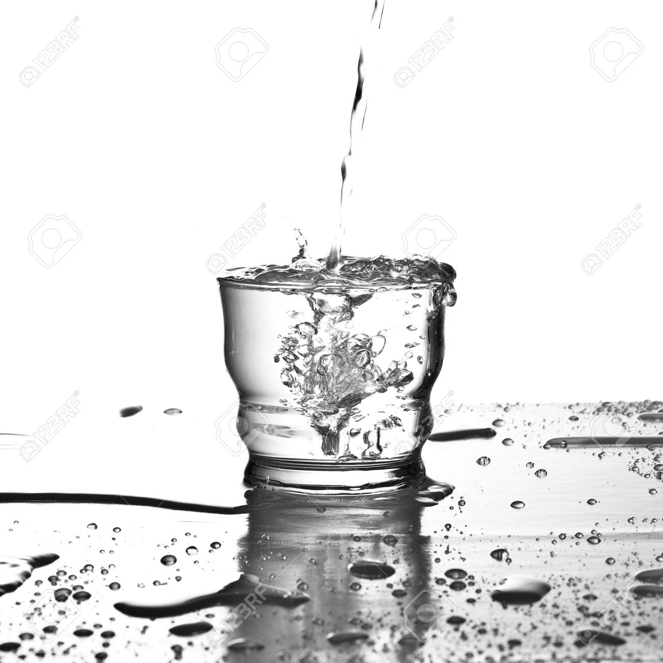 pouring water on glass on a white background Stock Photo - 7982719