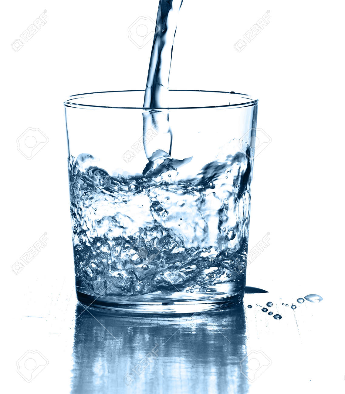 pouring water on a glass on white background Stock Photo - 8326662