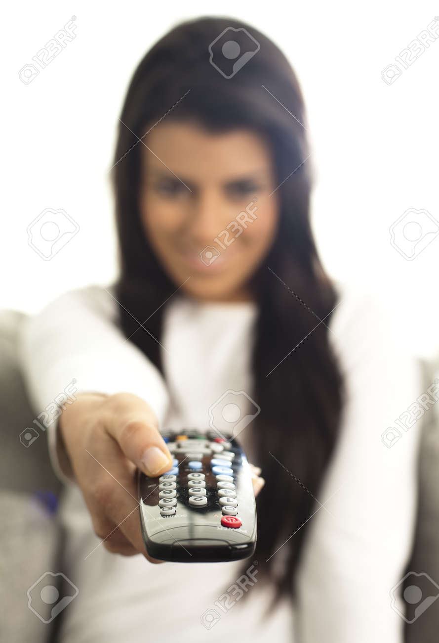young girl watching tv using a remote control Stock Photo - 8750041