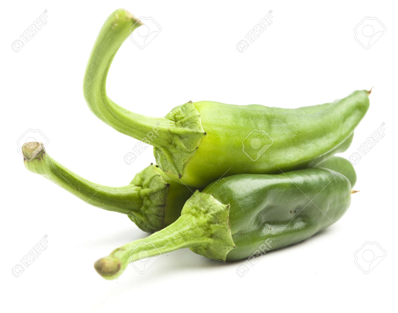 green peppers pile isolated on a white background Stock Photo - 8771718