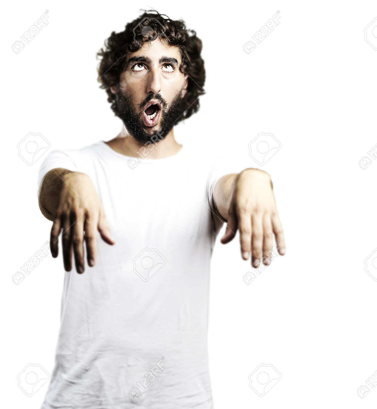 young man imitating a zombie against a white background Stock Photo - 10383797