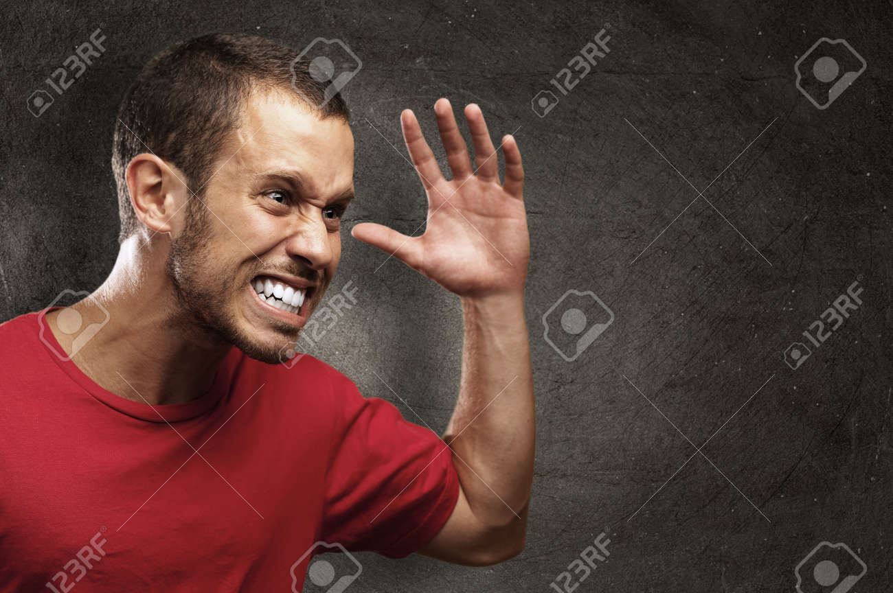 angry young man against a grunge background Stock Photo - 10383611