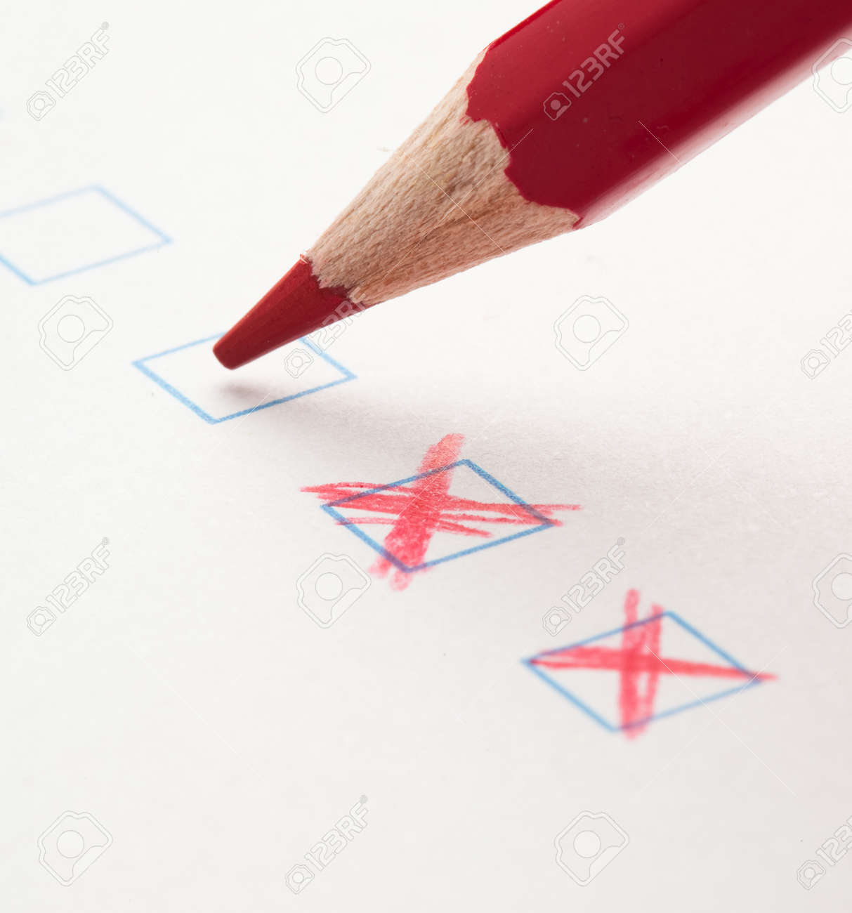 test check box and red crayons, closeup photo Stock Photo - 10382450