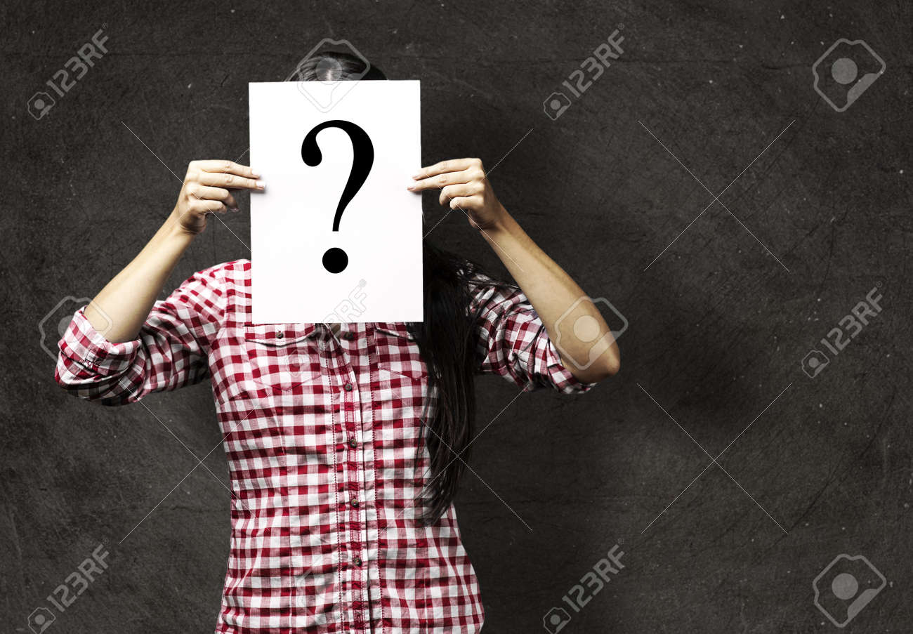 portrait of young woman showing a interrogation symbol against a vintage background Stock Photo - 10550715
