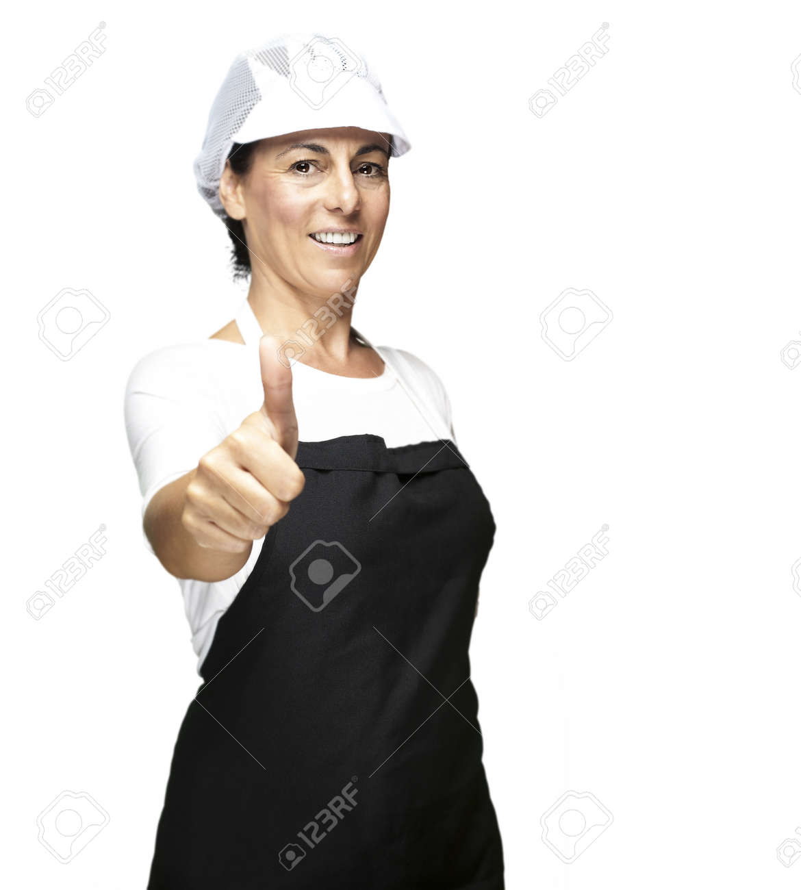White apron and hat - Stock Photo Portrait Of Cook Wearing Apron And Mesh Top Hat Doing Okey Symbol Against White Background