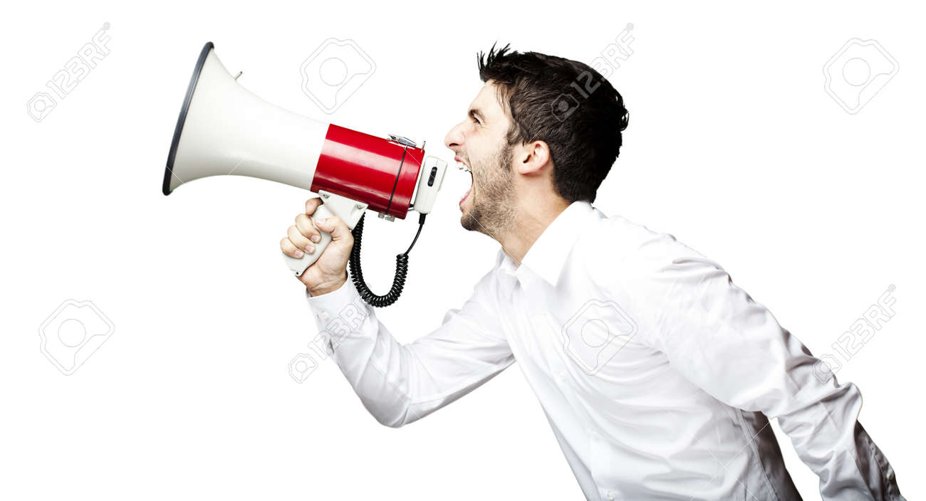 portrait of young man handsome shouting using megaphone over black background Stock Photo - 11506228