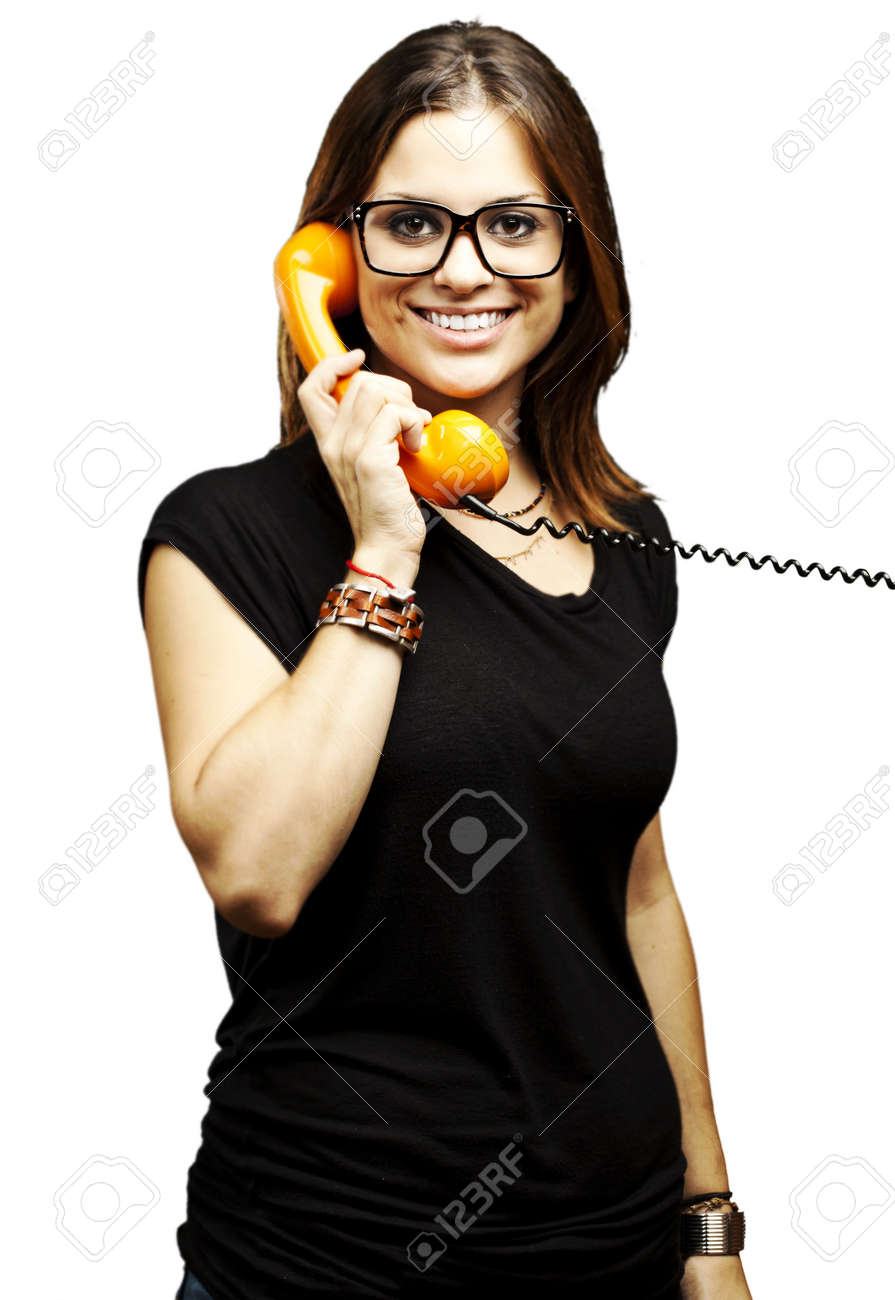 portrait of young woman talking using vintage telephone over white background Stock Photo - 11506147