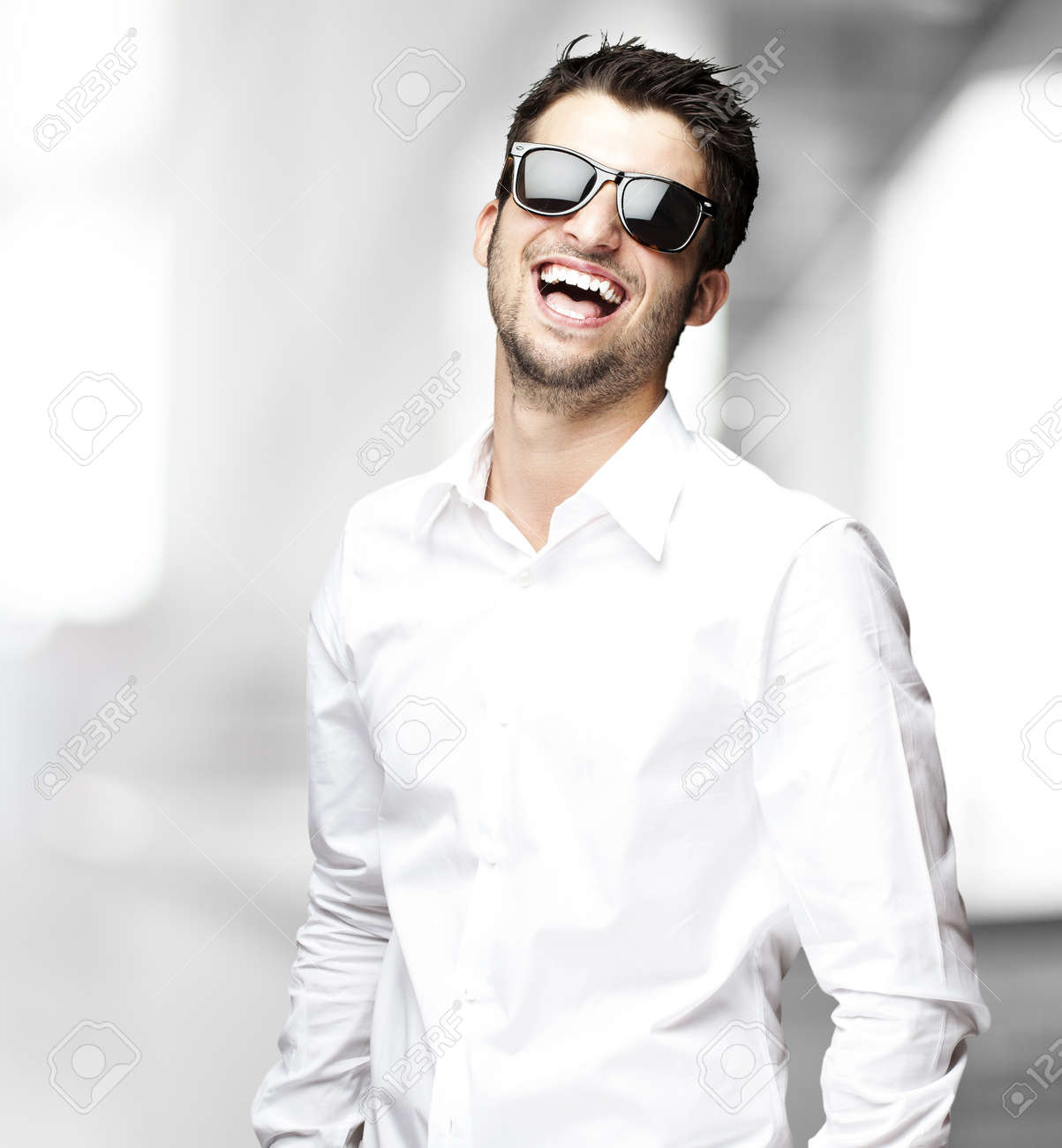 portrait of handsome young man smiling indoor Stock Photo - 11507036