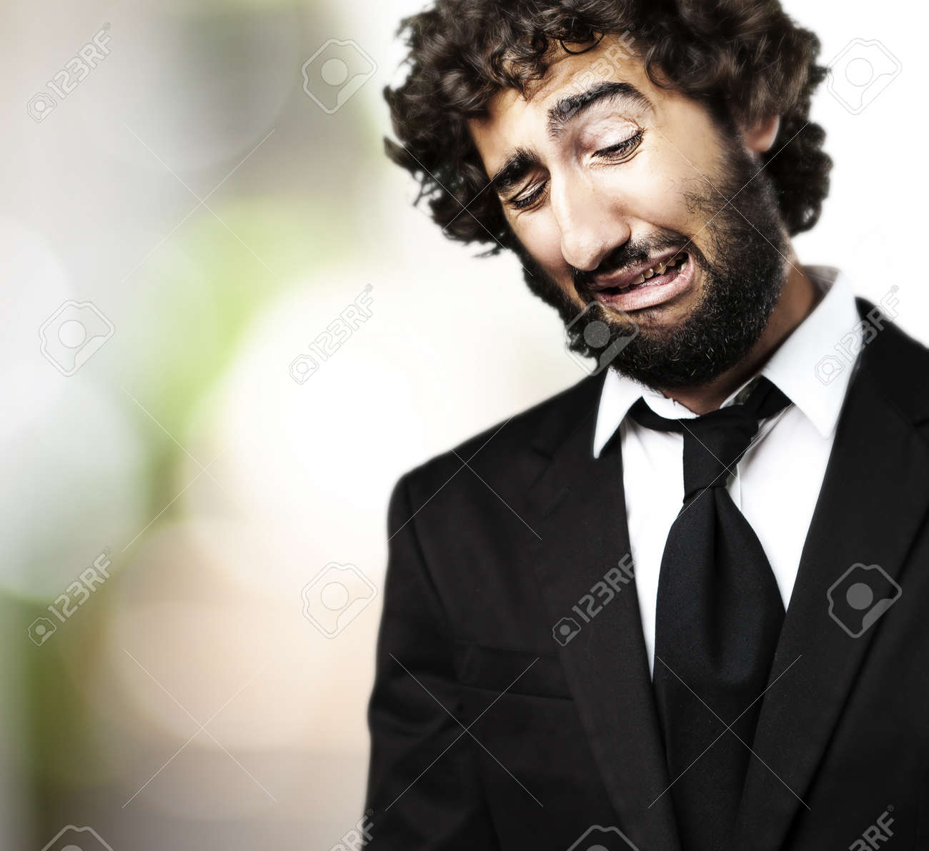 portrait of young business man with suit crying against a plants background Stock Photo - 11497108