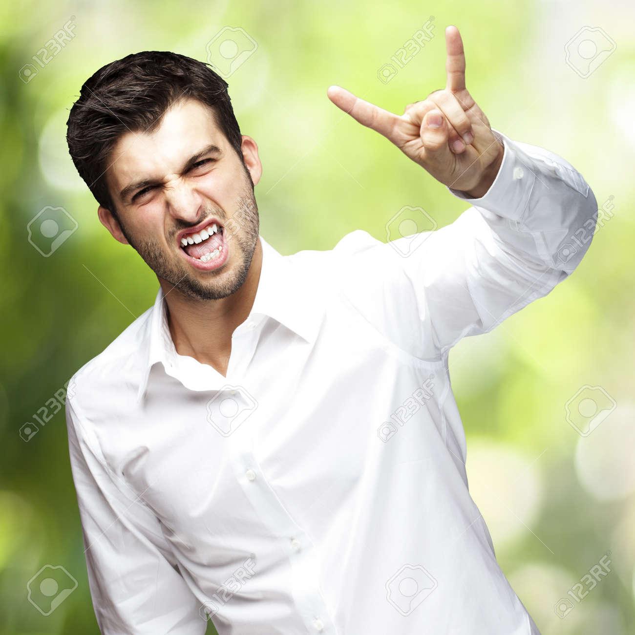 man doing rock gesture Stock Photo - 13486137