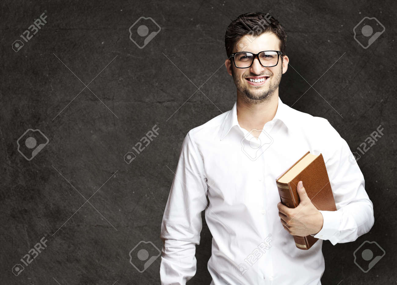 portrait of young student holding books against a grunge background Stock Photo - 12105206