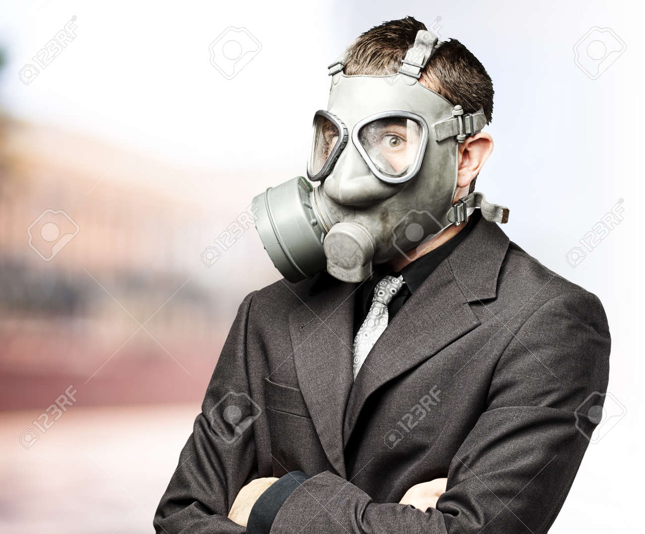 portrait of business man with gas mask against at outdoor Stock Photo - 12112138