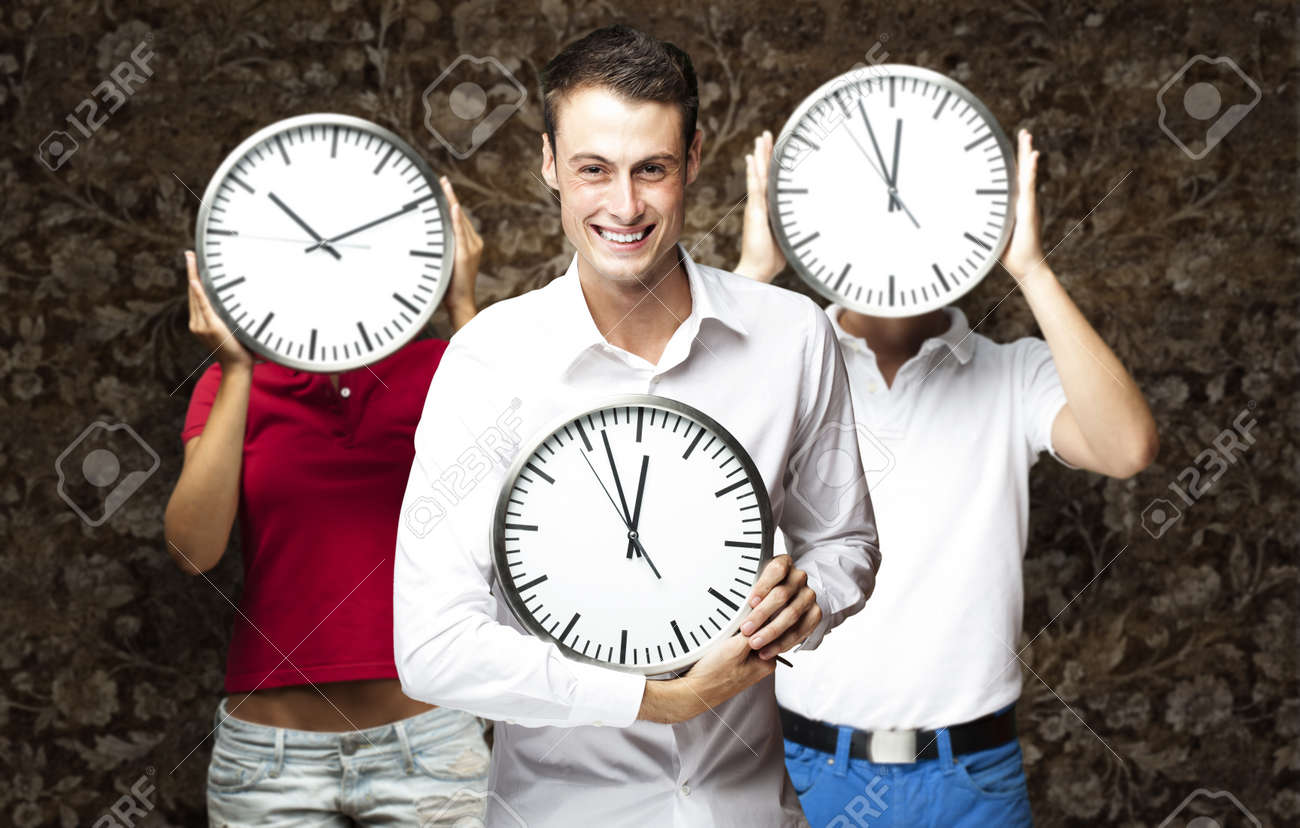 group of young students holding clock against a vintage wall Stock Photo - 13156192