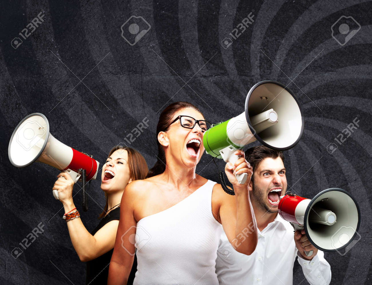 people shouting with megaphone against a grunge wall Stock Photo - 12656362