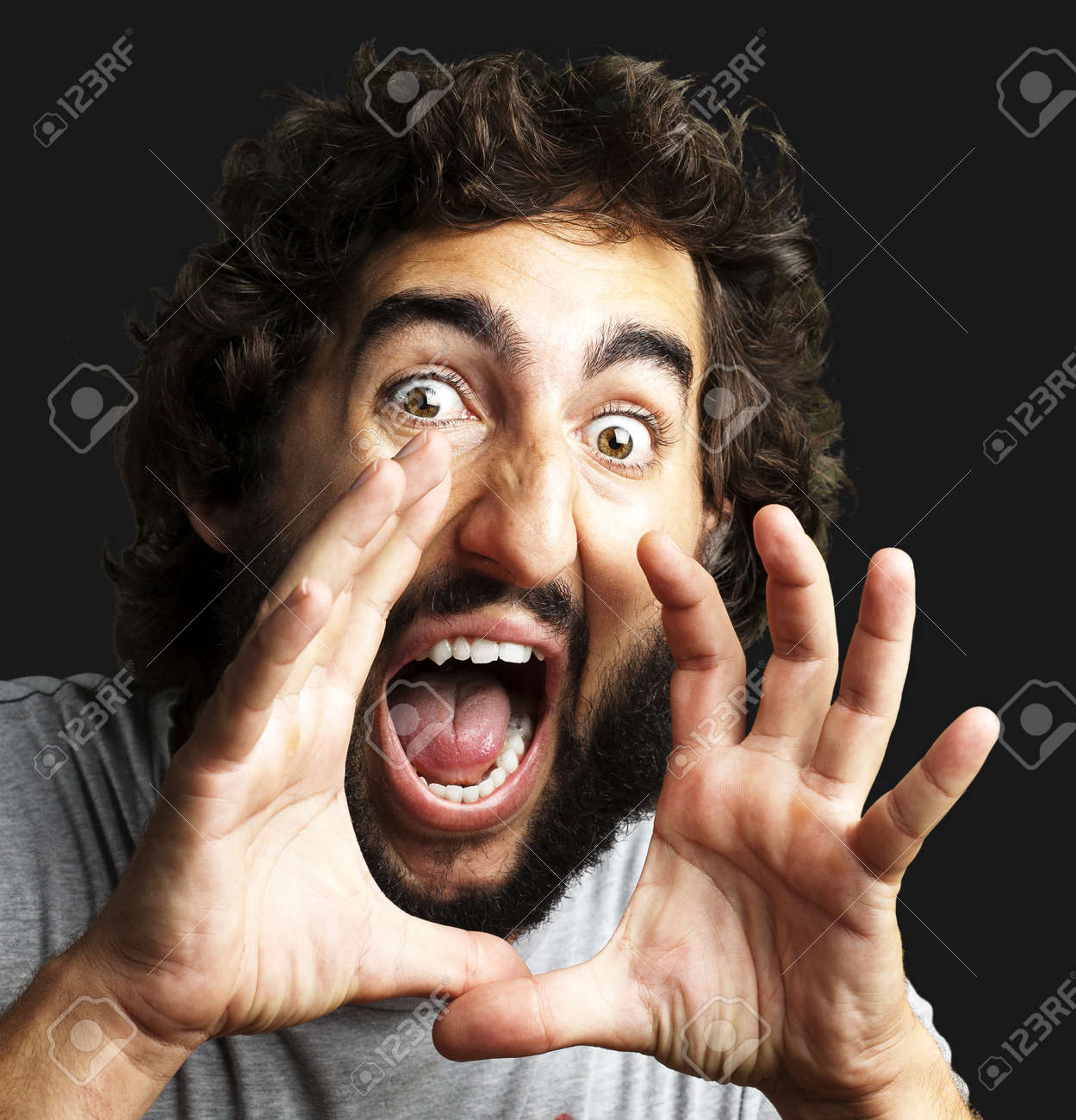 portrait of young man screaming against a black background Stock Photo - 12656806
