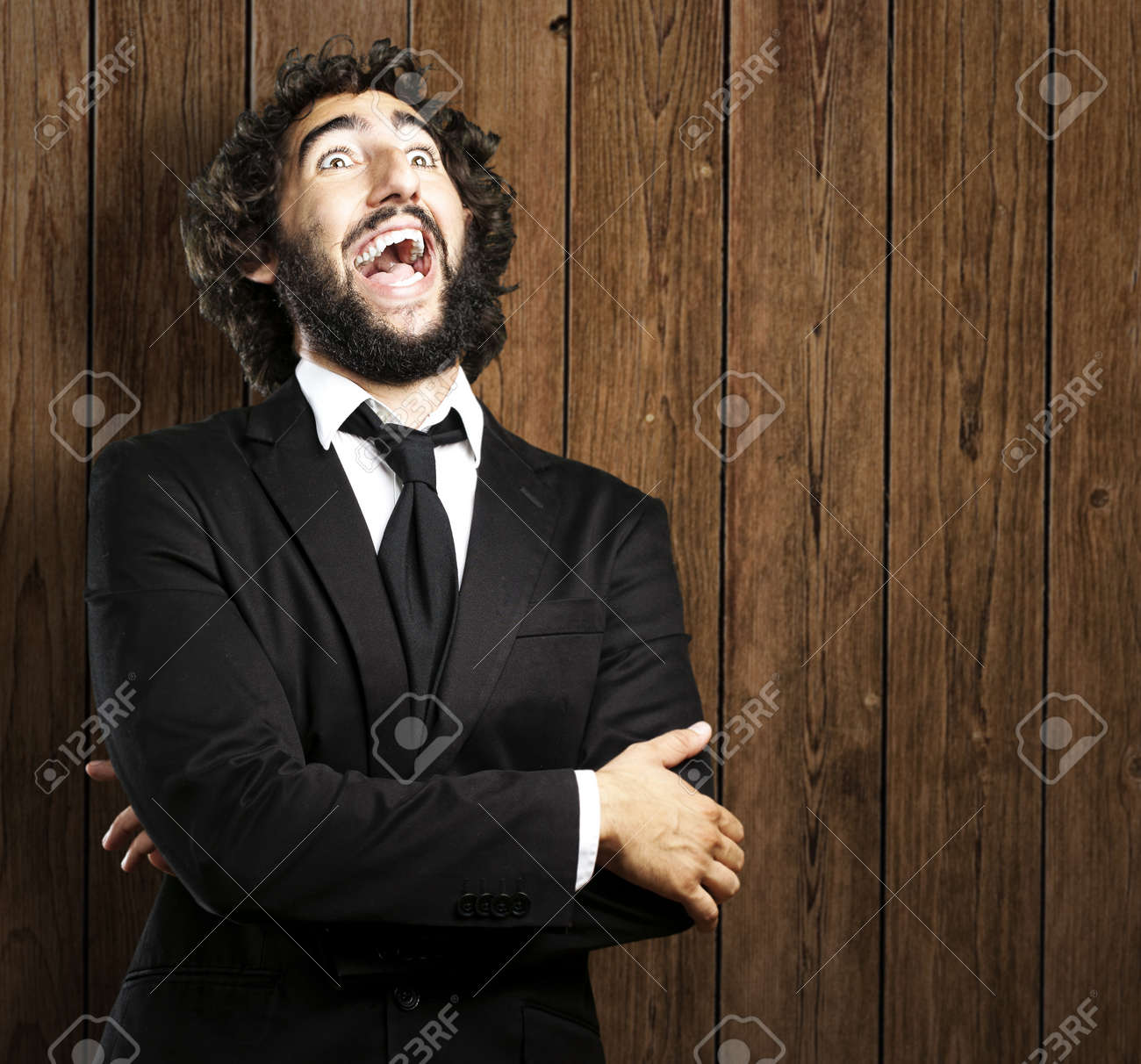 portrait of business man laughing against a wooden wall Stock Photo - 13156633