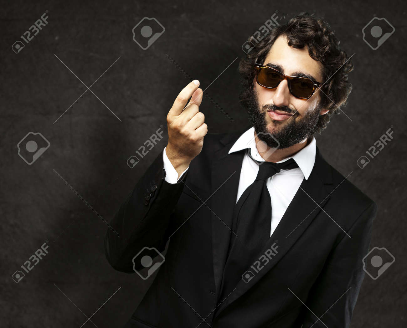 portrait of young business man gesturing money against a grunge wall Stock Photo - 13156319