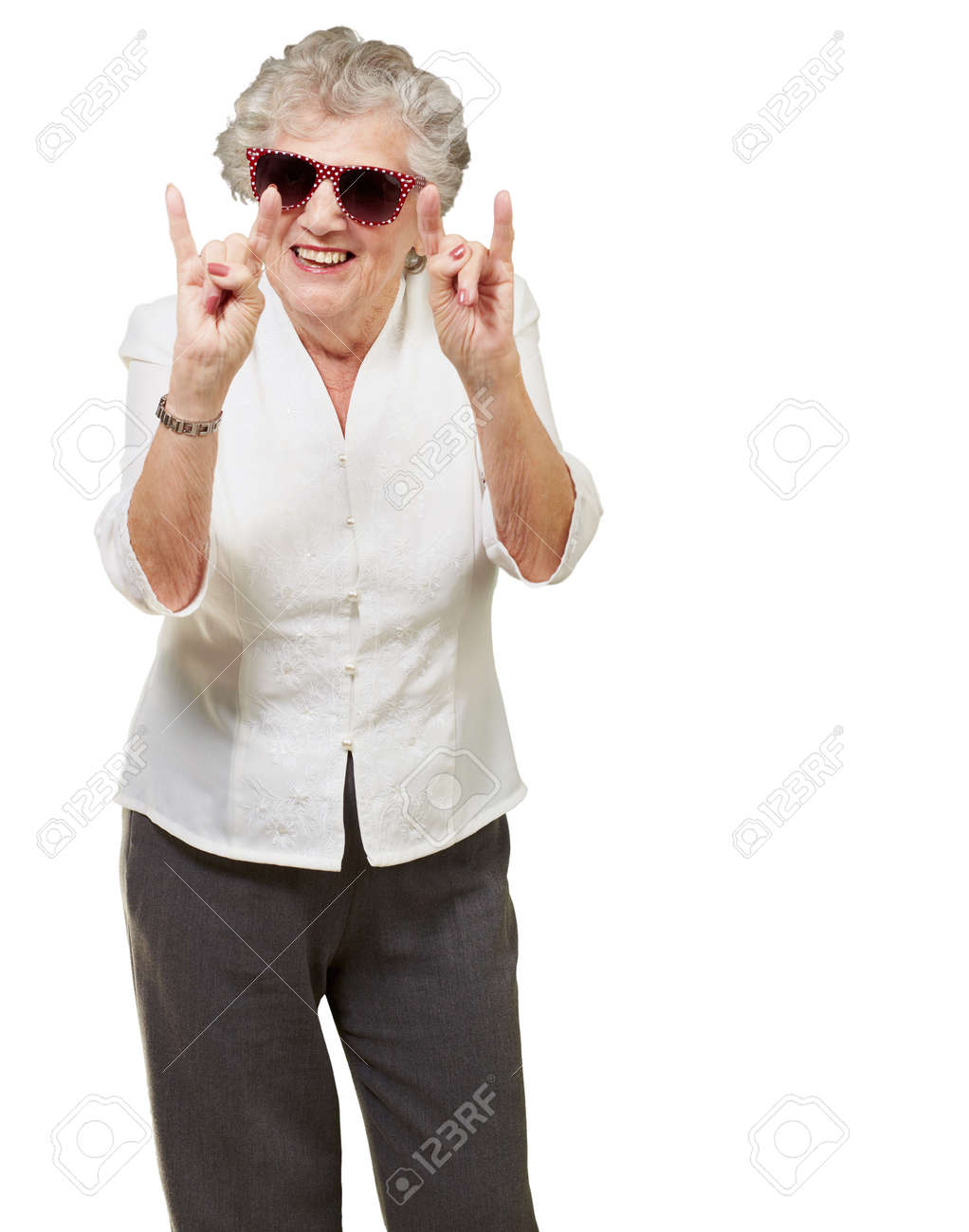 portrait of a happy senior woman doing rock symbol over white background Stock Photo - 13607928