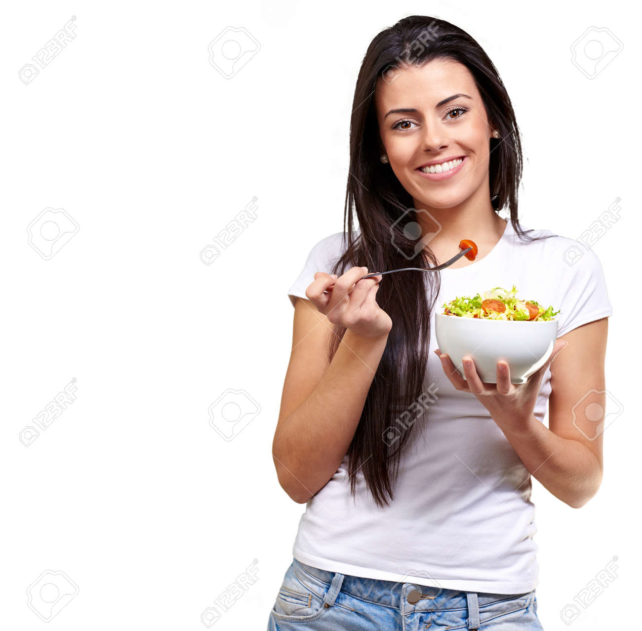 portrait of healthy woman eating salad against a white background Stock Photo - 13609608