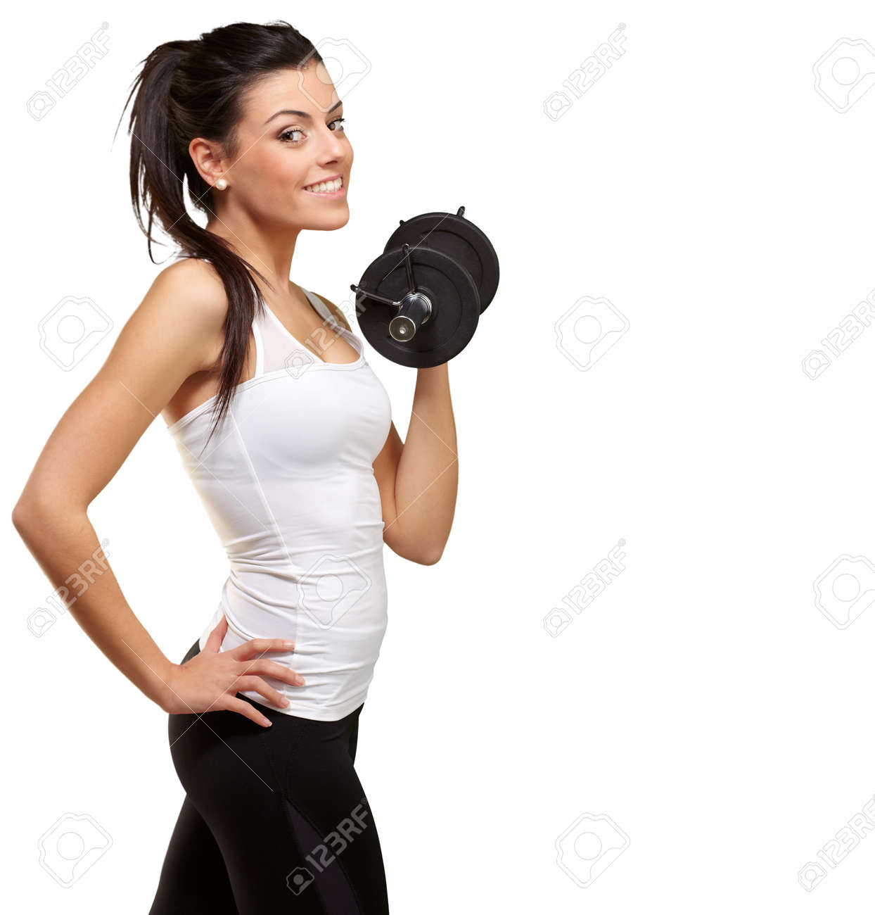 portrait of a young pretty woman holding weights and doing fitness against a white background Stock Photo - 13844733