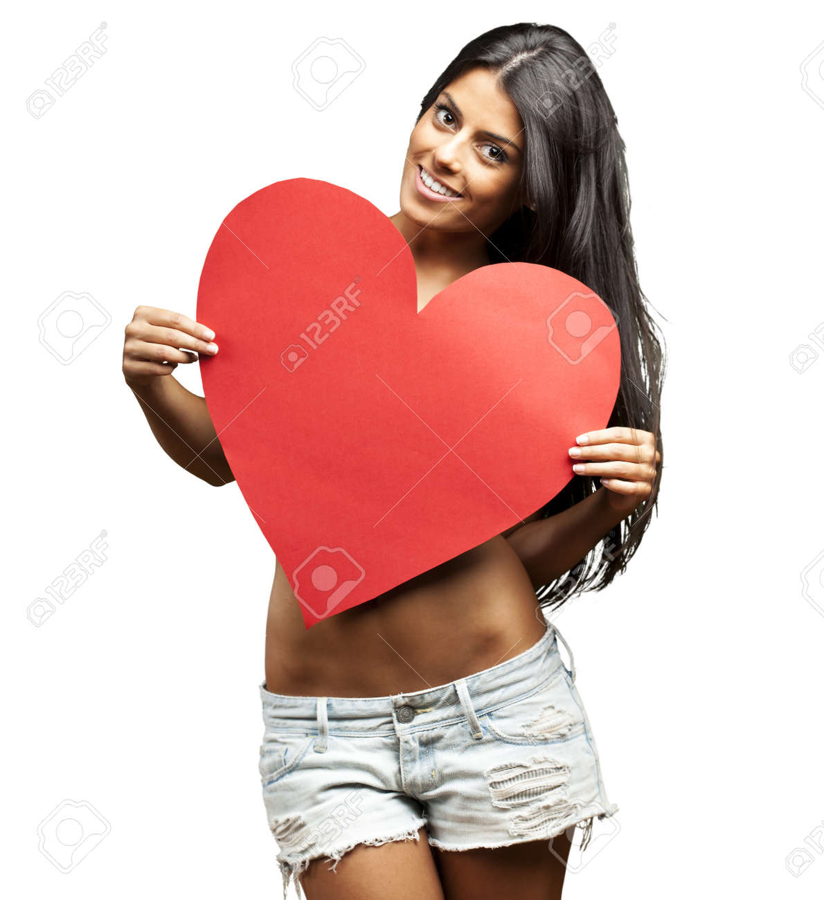 portrait of young woman holding red heart against a white background Stock Photo - 14439019